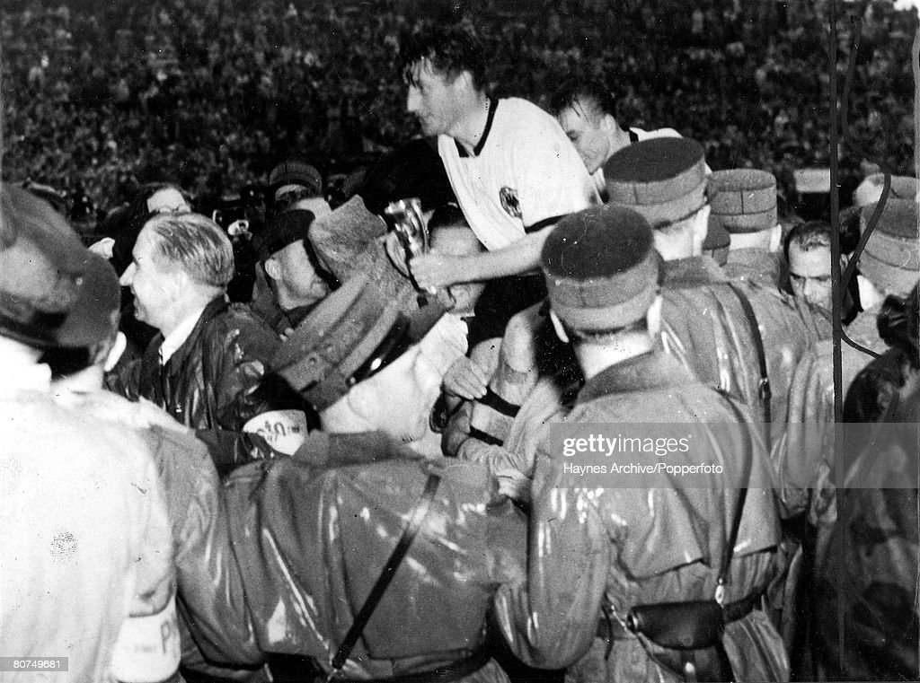 Football, 4th July 1954, World Cup Finals, Berne, Switzerland, Finals, West Germany 3 v Hungary 2, The victorious West German captain Fritz Walter is chaired off the pitch clutching the Jules Rimet Trophy after the match