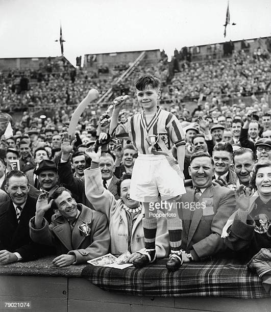 Football 4th May 1957 FA Cup Final Wembley Stadium London Aston Villa 2 v Manchester United 1 A proud young fan dressed in Aston Villa colours...