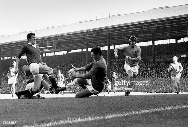 Football, 4th September 1971, Manchester United v Ipswich Town, Ipswich Town goalkeeper David Best saves from the feet of Manchester United's Alan...