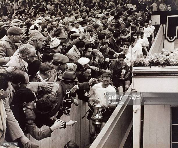 Football 6th May 1961 Wembley Stadium London FA Cup Final Tottenham Hotspur 2 v Leicester City 0 Spurs captain Danny Blanchflower carries the trophy...