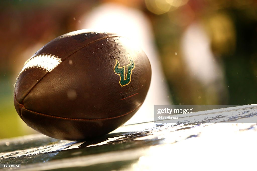 A football adorned with the South Florida Bulls logo sits on a crate on the sidelines during the fourth quarter of an NCAA football game between the Bulls and the Houston Cougars on October 28, 2017 at Raymond James Stadium in Tampa, Florida.