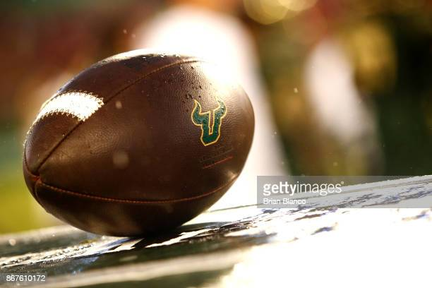 A football adorned with the South Florida Bulls logo sits on a crate on the sidelines during the fourth quarter of an NCAA football game between the...