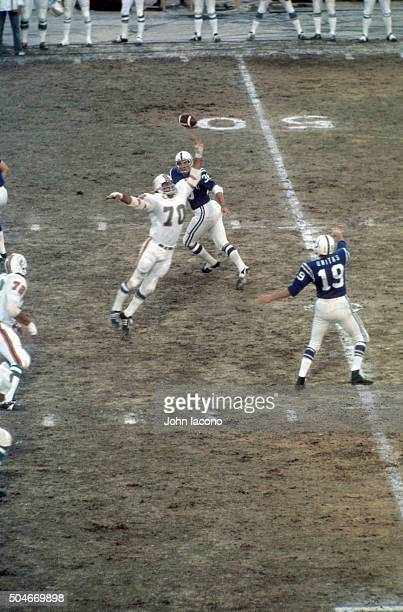 Aerial rear view of Baltimore Colts QB Johnny Unitas in action passing to Norm Bulaich vs Miami Dolphins Jim Riley at Memorial Stadium Baltimore MD...
