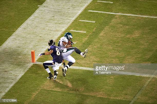 Aerial rear view of Philadelphia Eagles Jarrad Page in action making interception vs Baltimore Ravens Tandon Doss during preseason game at Lincoln...