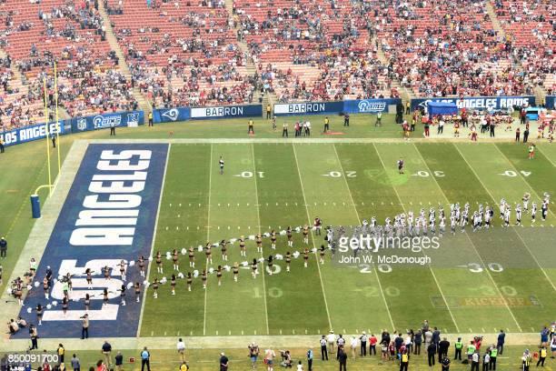 Aerial view of Los Angeles Rams cheerleaders and players on field before game vs Washington Redskins at Los Angeles Memorial Coliseum Los Angeles CA...