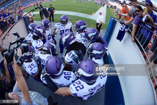 Aerial view of Minnesota Vikings players about to take field with teammates before preseason game vs Denver Broncos at Mile High Stadium Denver CO...