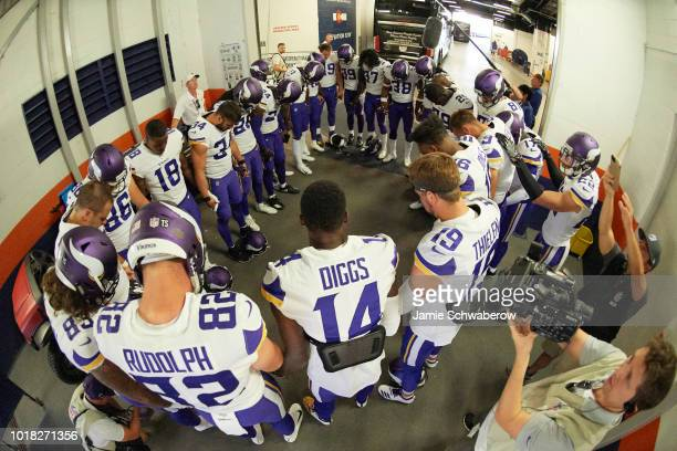 Aerial view of Minnesota Vikings players in huddle in runway about to take field before preseason game vs Denver Broncos at Mile High Stadium Denver...