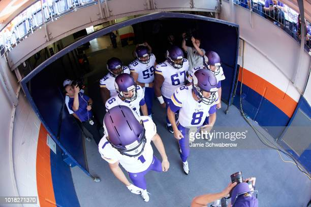 Aerial view of Minnesota Vikings QB Kirk Cousins about to take field with teammates before preseason game vs Denver Broncos at Mile High Stadium...