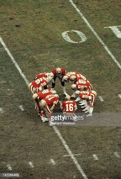 Aerial view of San Francisco 49ers QB Joe Montana in huddle with teammates during game vs Houston Oilers at Candlestick Park San Francisco CA CREDIT...