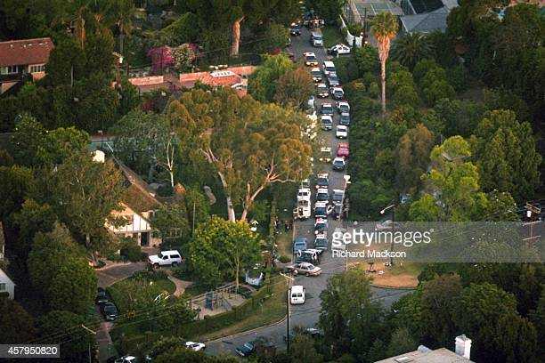 Aerial view shot from helicopter of home of OJ Simpson white Ford Bronco parked in driveway and police cars parked outside Simpson returned to his...