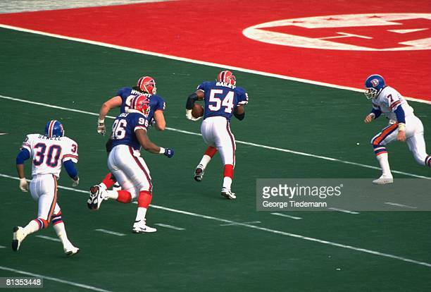 Football AFC Championship Buffalo Bills Carlton Bailey in action and victorious scoring TD after making interception vs Denver Broncos Orchard Park...