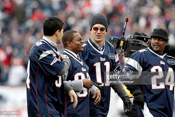 Championship: Former New England Patriots Tedy Buschi, Troy Brown, QB Drew Bledsoe, and Ty Law on field before game vs Baltimore Ravens at Gillette...