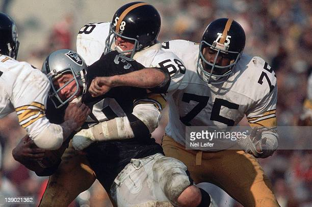 AFC Championship Pittsburgh Steelers Joe Greene and Jack Lambert in action vs Oakland Raiders Mark Van Eeghen at OaklandAlameda County Stadium...