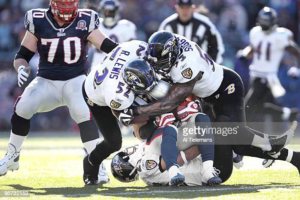 AFC Playoffs Baltimore Ravens Ray Lewis and Terrell Suggs in action making pileup tackle vs New England Patriots Julian Edelman Foxboro MA 1/10/2010...