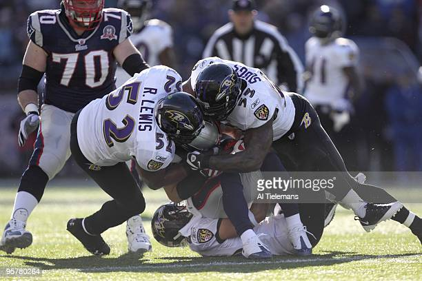 AFC Playoffs Baltimore Ravens Ray Lewis and Terrell Suggs in action vs New England Patriots Julian Edelman Foxboro MA 1/10/2010 CREDIT Al Tielemans