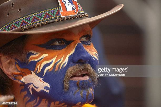 AFC Playoffs Closeup of Denver Broncos fan in stands with face painted in team colors during game vs Indianapolis Colts at Sports Authority Field at...