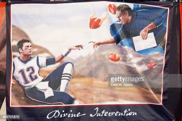 AFC Playoffs Closeup view of New England Patriots banner that reads DIVINE INTERVENTION with QB Tom Brady and coach Bill Belichick pictured during...