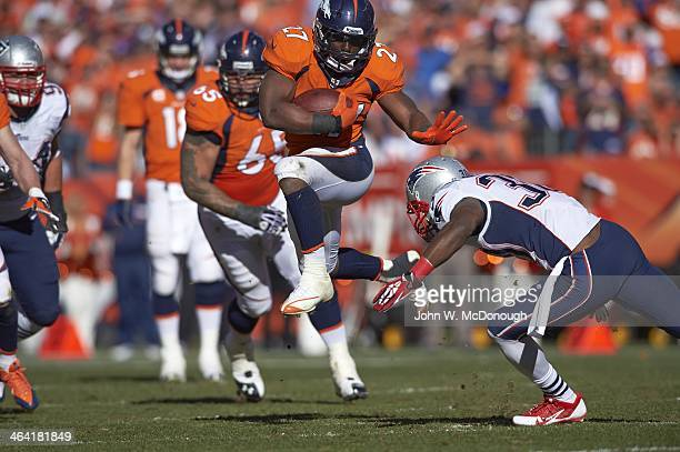 AFC Playoffs Denver Broncos Knowshon Moreno in action rushing and avoiding tackle vs New England Patriots Duron Harmon at Sports Authority Field at...