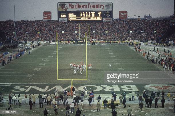 Football AFC playoffs Denver Broncos Rich Karlis victorious after making winning field goal kick vs Cleveland Browns View of scoreboard at Cleveland...