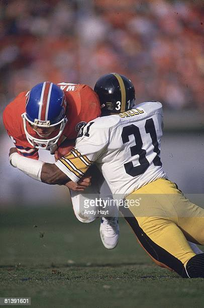 Football AFC Playoffs Denver Broncos Steve Watson in action during tackle vs Pittsburgh Steelers Donnie Shell Denver CO
