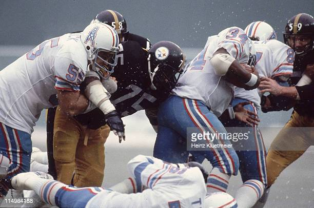 AFC Playoffs Houston Oilers Earl Campbell in action vs Pittsburgh Steelers Jack Ham and Joe Greene at Three Rivers Stadium Pittsburgh PA CREDIT Heinz...