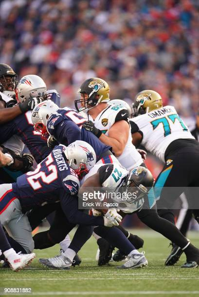 AFC Playoffs Jacksonville Jaguars Leonard Fournette in action rushing vs New England Patriots Elandon Roberts at Gillette Stadium Foxborough MA...