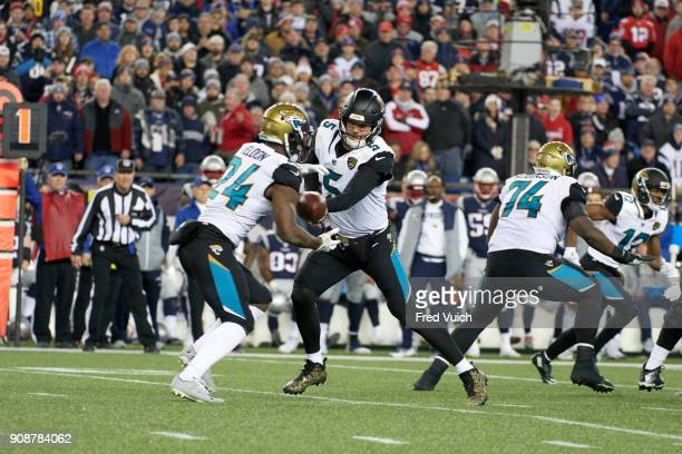AFC Playoffs Jacksonville Jaguars QB Blake Bortles in action handing off to TJ Yeldon vs New England Patriots at Gillette Stadium Foxborough MA...