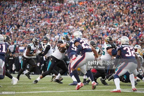AFC Playoffs Jacksonville Jaguars QB Blake Bortles in action handing off to Leonard Fournette vs New England Patriots at Gillette Stadium Foxborough...