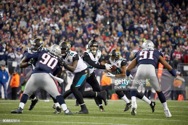 AFC Playoffs Jacksonville Jaguars QB Blake Bortles in action handing off to Corey Grant vs New England Patriots at Gillette Stadium Foxborough MA...