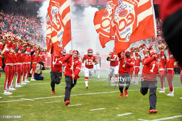 AFC Playoffs Kansas City Chiefs Anthony Sherman taking field with teammates and cheerleaders before game vs Houston Texans at Arrowhead Stadium...