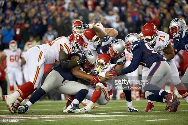 AFC Playoffs Kansas City Chiefs Charcandrick West in action rushing and being tackled vs New England Patriots Akiem Hicks at Gillette Stadium...