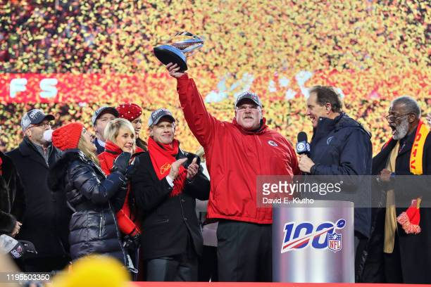 AFC Playoffs Kansas City Chiefs coach Andy Reid victorious holding up Lamar Hunt trophy duirng interview with CBS announcer Jim Nantz after game vs...