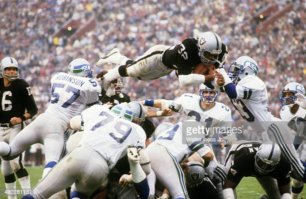 AFC Playoffs Los Angeles Raiders Marcus Allen in action going over the top vs Seattle Seahawks at Los Angeles Memorial Coliseum Los Angeles CA CREDIT...