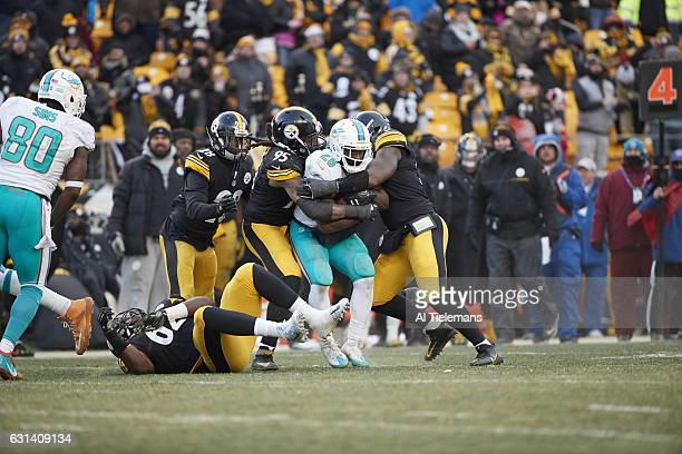 AFC Playoffs Miami Dolphins Damien Williams in action rushing vs Pittsburgh Steelers Jarvis Jones at Heinz Field Pittsburgh PA CREDIT Al Tielemans