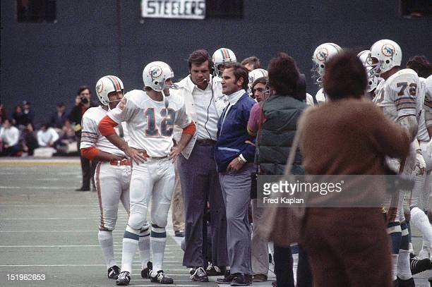AFC Playoffs Miami Dolphins head coach Don Shula talking to QB Bob Griese and Garo Yepremian on sidelines during game vs Pittsburgh Steelers at Three...