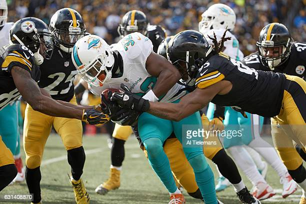 AFC Playoffs Miami Dolphins Kenyan Drake in action rushing vs Pittsburgh Steelers Jarvis Jones at Heinz Field Pittsburgh PA CREDIT Al Tielemans