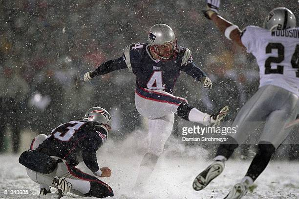 Football AFC playoffs New England Patriots Adam Vinatieri in action making kick during game with snow weather vs Oakland Raiders Foxboro MA 1/19/2002