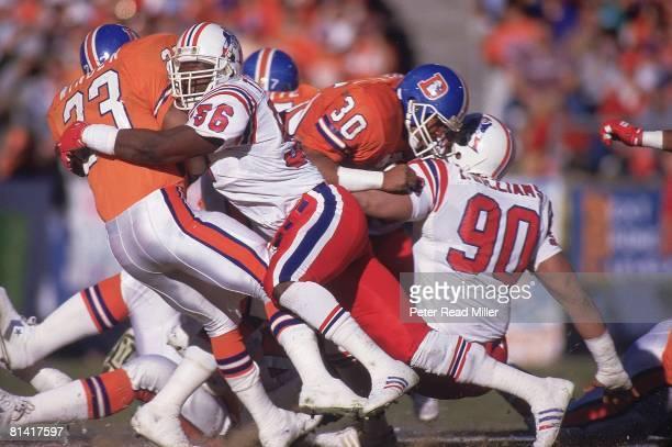 Football: AFC playoffs, New England Patriots Andre Tippett in action vs Denver Broncos Sammy Winder , Denver, CO 1/4/1987