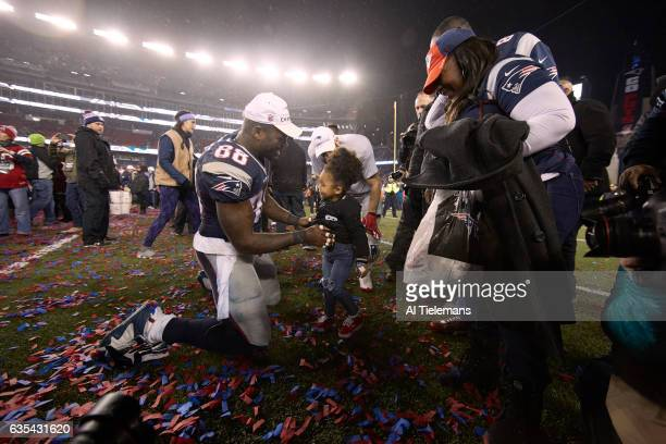 AFC Playoffs New England Patriots Martellus Bennett victoious with daughter Austyn after winning game vs Pittsburgh Steelers at Gillette Stadium...