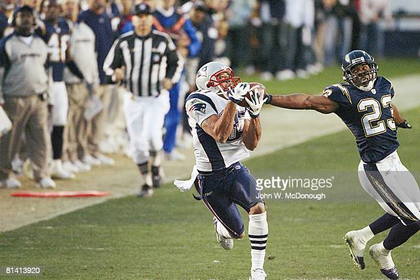 Football AFC Playoffs New England Patriots Reche Caldwell in action making 4th quarter catch vs San Diego Chargers Quentin Jammer San Diego CA...