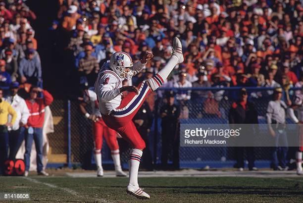 Football AFC playoffs New England Patriots Rich Camarillo in action making punt vs Denver Broncos Denver CO 1/4/1987