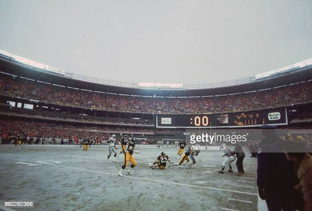 AFC Playoffs Oakland Raiders Cliff Branch in action being tackled on 15yard line as time expires vs Pittsburgh Steelers at Three Rivers Stadium View...