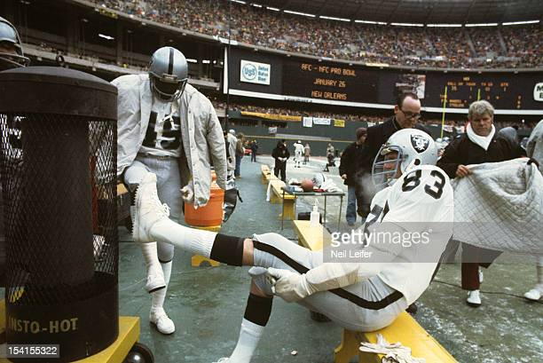 AFC Playoffs Oakland Raiders Ted Hendricks and Neal Colzie on sidelines during game vs Pittsburgh Steelers at Three Rivers Stadium View of InstoHot...