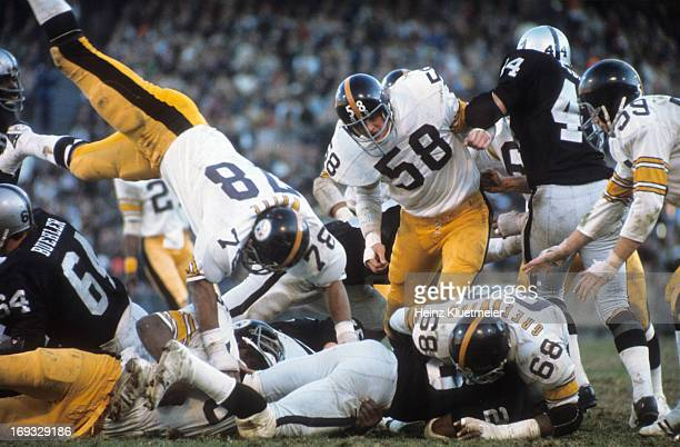 AFC Playoffs Pittsburgh Steelers Dwight White Jack Lambert LC Greenwood and Jack Ham in action pileup tackle vs Oakland Raiders at Oakland–Alameda...
