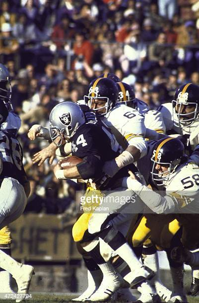 AFC Playoffs Pittsburgh Steelers Ernie Holmes and Jack Lambert in action tackle vs Oakland Raiders Marv Hubbard at Alameda County Coliseum Oakland CA...