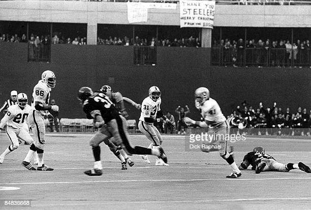 AFC Playoffs Pittsburgh Steelers Franco Harris in action making catch vs Oakland Raiders Phil Villapiano Ball was deflected as a result of Raiders...