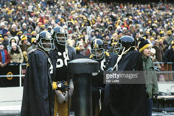 AFC Playoffs Pittsburgh Steelers Jimmy Allen LC Greenwood and Dave Brown standing on sidelines next to InstoHot portable heater during game vs...