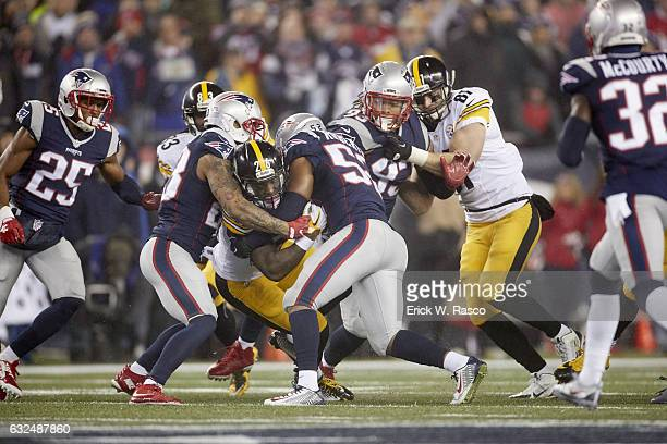 AFC Playoffs Pittsburgh Steelers Le'Veon Bell in action rushing vs New England Partriots Elandon Roberts at Gillette Stadium Foxborough MA CREDIT...
