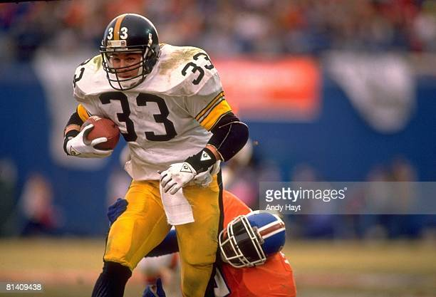 Football AFC Playoffs Pittsburgh Steelers Merril Hoge in action rushing vs Denver Broncos Steve Atwater Denver CO 1/7/1990