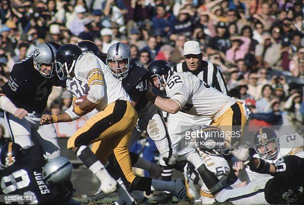 AFC Playoffs Pittsburgh Steelers Mike Webster and Franco Harris in action vs Oakland Raiders at OaklandAlameda County Coliseum Oakland CA CREDIT...